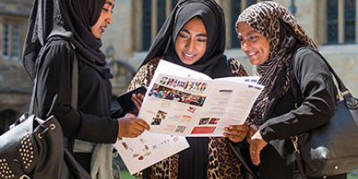 Students looking at open day guide